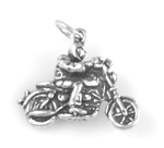 Silver motorcycle with rider charm